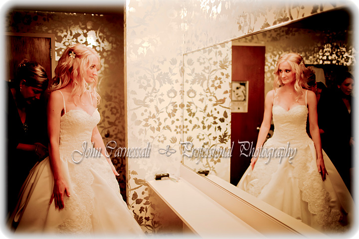 Bride looking into the mirror on her wedding day.